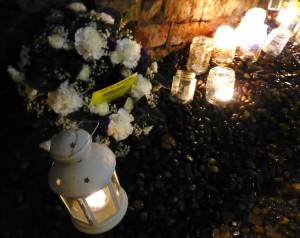Flowers & candles laid in remembrance and solidarity